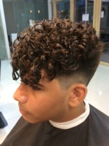 side shot of man with perm