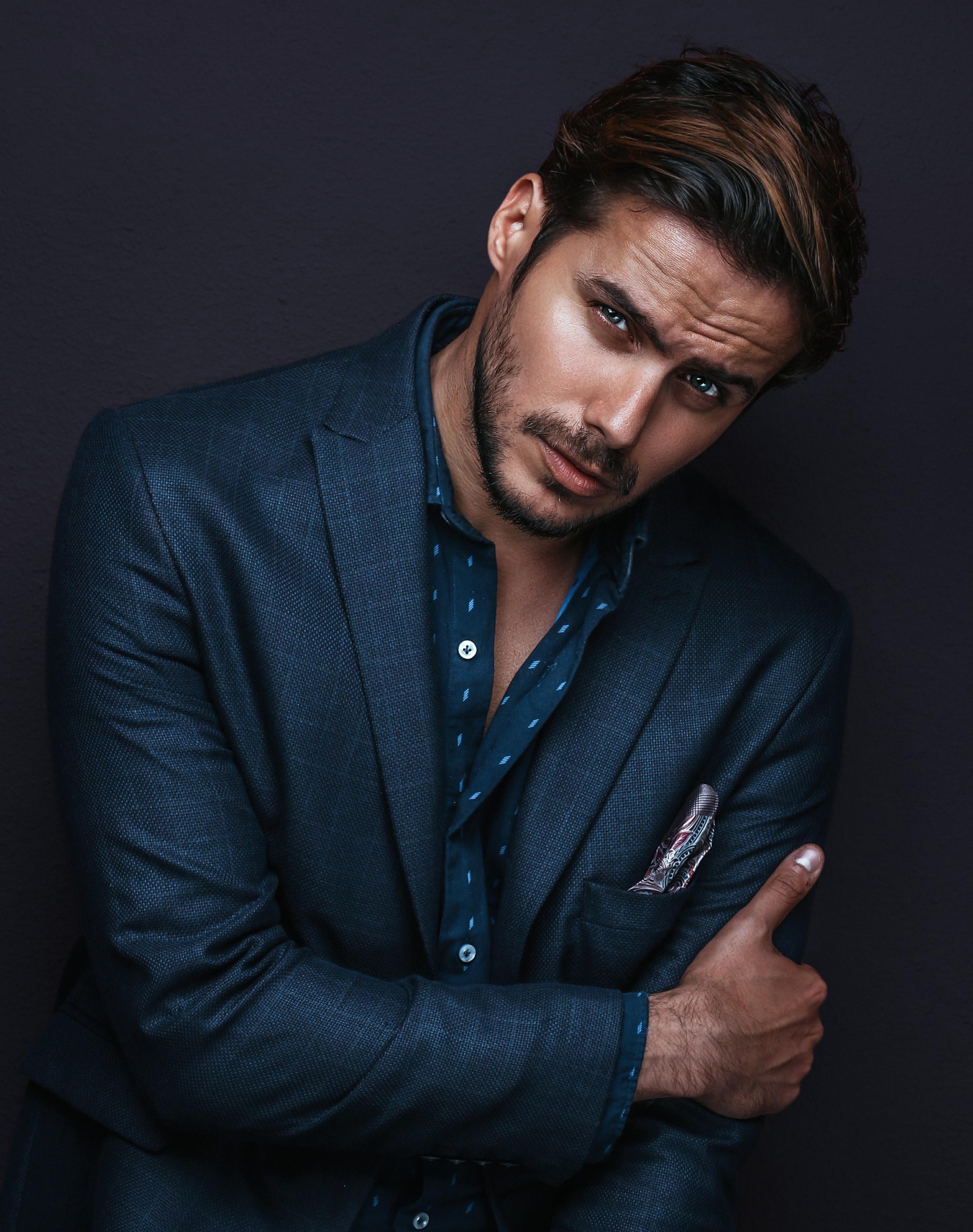 Male model posing wearing a blue suit